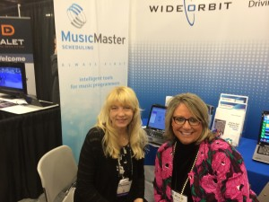 Marianne and Melanie in the Wid Orbit booth at NRB