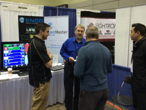 Ken Frommert and Dave Turner from our vendor partners Enco at our shared booth space at the Great Lakes Radio Conference in Lansing, Michigan  speaking to visitors
